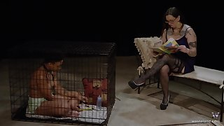 Ebony lesbian waiting upon masturbates in a cage by her mistresses orders