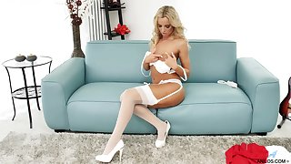Seductive white lingerie on a tanned blonde beauty
