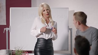 Student can't believe that hot teacher in leather skirt seduces him