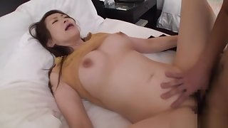 Naughty Asian babe gets the brush wet muff teased indoors