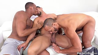 Muscular gay men are having a wild time fucking in threesome