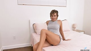 Low-spirited mature woman Lillian Tesh gets naked and masturbates pussy with sex toys
