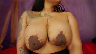 Fat irritant ghetto ebony with tattooed tits and big nipples exceeding webcam