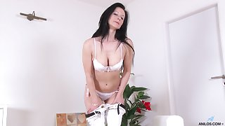Anorectic brunette model Enza in white lingerie having solo fun