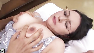 Mature Japanese MILF in all directions glasses gives a tijob and gets fucked