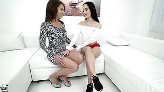 Lesbian sporty teens Sasha Sparrow and Viol fingering each other