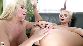 Busty mature lesbian couple Vinna Reed and Pam Pink have intercourse